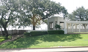 Dealey Plaza Pergola sits atop a sloping hill known as the Grassy Knoll