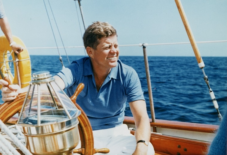 JFK President Kennedy at the wheel of Coast Guard Yacht Manitou