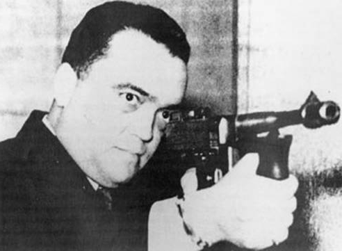 J. Edgar Hoover with machine gun - tommy gun